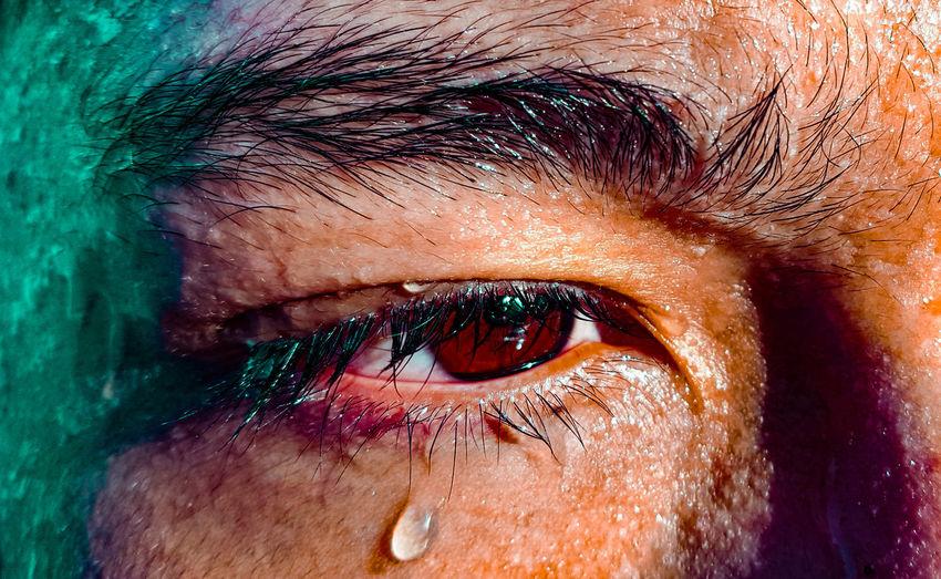 Close-up of man crying