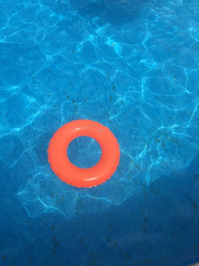High Angle View Of Inflatable Ring Floating On Swimming Pool