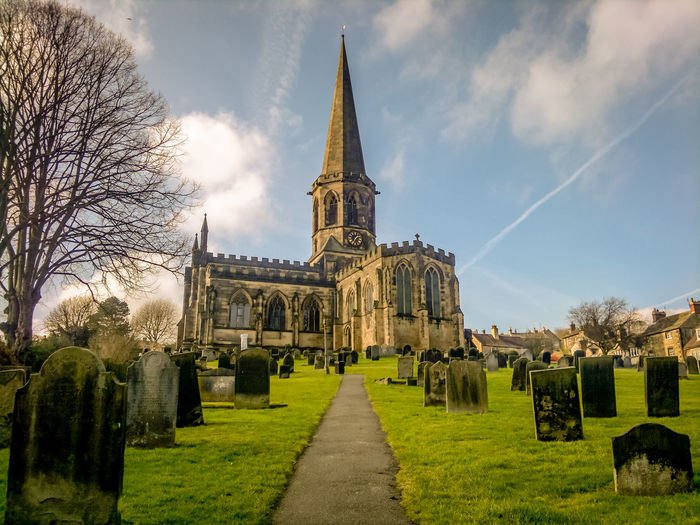 Bakewell Parish Church Architecture Bakewell Bakewell Parish Church Building Exterior Built Structure Church Cloud Cloud - Sky Day Derbyshire Famous Place Grass Grave Graveyard History Place Of Worship Religion Sky Travel Travel Destinations Tree