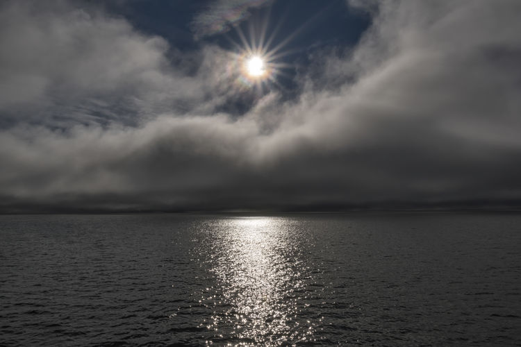 Cold sun Arctic Sea Beauty In Nature Cloud Cloud - Sky Cloud And Sky Dark Darkness And Light Day EyeEmNewHere Horizon Over Water Landscape Landscape Photography Nature Scenics Sea Sky Sun Sun And Clouds Sun Rays Sunlight Tranquil Scene Tranquility