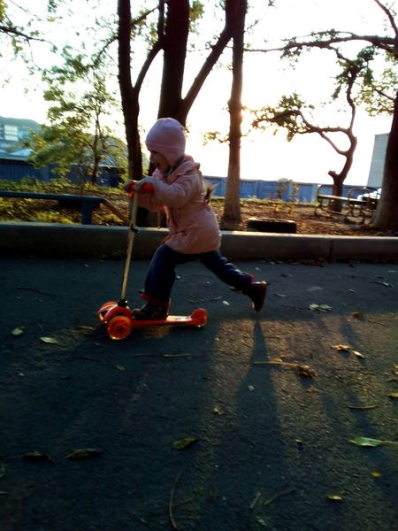 Speed! Push Scooter Child Girl Courage Children Only Childhood Fun Headwear One Person Leisure Activity Day Real People Playground People Evening Sunset Colors Evening Light Asphalt Autumn