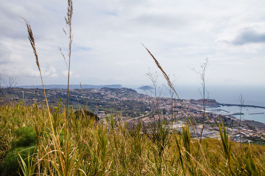 Landscape and nature in the bay of naples Bay Bay Of Naples Beauty In Nature Cloud - Sky Day Grass Growth Marram Grass Mountain Naples Napoli Nature Nisi No People Outdoors Plant Pozzuoli Scenics Sea Sky Tall Grass Tranquil Scene Tranquility Water Yacht