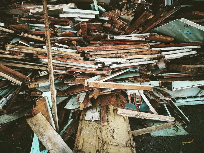 Stacked Abandoned Wooden Furniture At Junkyard