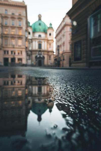 Classic Vienna on Sunday morning Austria Church Morning Light Reflection Vienna Architecture Blurred Background Building Exterior City Eyem Best Shots Graben Moody Weather No People Peters Church Peterskirche Puddle Puddle Reflections Rain Reflection Street Surface Level Travel Destinations Wet The Architect - 2018 EyeEm Awards