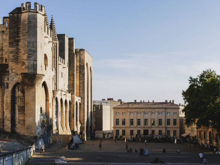 Avignon 0 Pope Adult Arch Architectural Column Architecture Building Building Exterior Built Structure City Day Group Of People History Large Group Of People Men Nature Outdoors Palace Real People Sky The Past Tourism Travel Travel Destinations Warm Colors Women