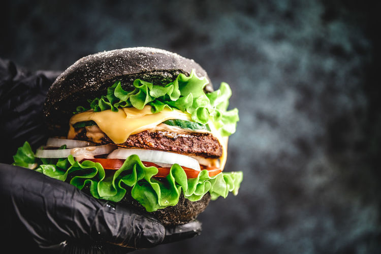 Black Bun Patty Beef Marble BIG Gloves Man Hands Hold Hamburger Burger Grilled person Eat Food Meat Fast Sandwich Eating Holding Hand Hungry Macro Photography Advertising Onion Meal CheeseBurger American Lettuce Closeup Tomato Cheese Hipster Vegetable Dinner Gourmet Snack Fast Food Food And Drink Unhealthy Eating Bread Freshness Take Out Food Ready-to-eat Close-up One Person Focus On Foreground Black Background The Foodie - 2019 EyeEm Awards