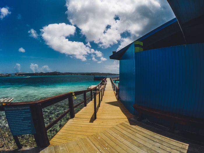 One happy island! De Palm Island Aruba One Happy Islan Aruba Aruba♥ EyeEm Selects Water Sky Sea Cloud - Sky Architecture Nature Blue Tranquility Horizon Over Water Beauty In Nature Day Built Structure Outdoors Sunlight