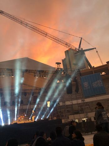Concert Sky Sunset Crowd Nature Cloud - Sky Architecture Large Group Of People Built Structure Group Of People Building Exterior Crane - Construction Machinery Orange Color Machinery Event Real People Illuminated Outdoors Lighting Equipment Water Spectator