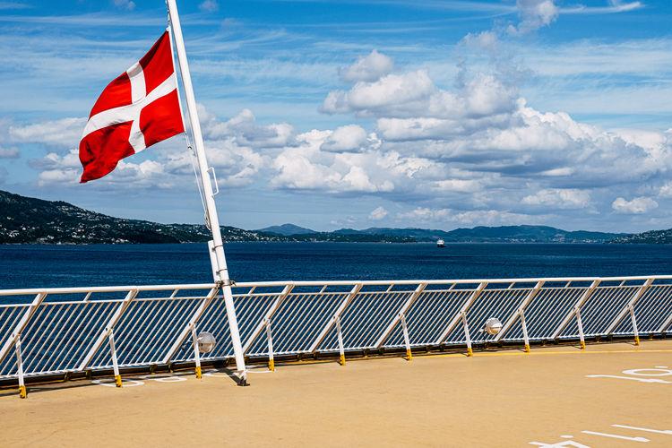 Flag on beach against sky