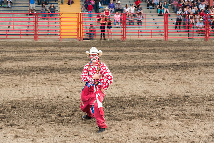 Williams Lake, British Columbia/Canada - July 1, 2016: a rodeo clown entertains the crowds during the 90th Williams Lake Stampede, one the the largest stampedes in North America 90th Williams Lake Stampede Arena British Columbia, Canada Canadian Professional Rodeo Association Fun Funny Happy Man Rodeo Rodeo Clown Silly Travel Candid Cheerful Clown Costume Documentary Editorial  Entertainer Entertainment Performance Professional Rodeo Red And White Stampede Tourism
