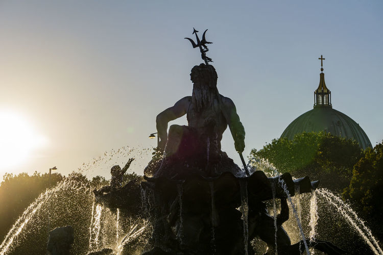 Close-Up of Neptune Fountain with Berlin Cathedral Against Afternoon Sun Berlin Germany 🇩🇪 Deutschland Color Image Horizontal Outdoors No People Silhouette Sky Sculpture Statue Representation Human Representation Art And Craft Nature Fountain Architecture Water Male Likeness Creativity Clear Sky Sunlight Berlin Cathedral Dome Low Sun Neptune Fountain