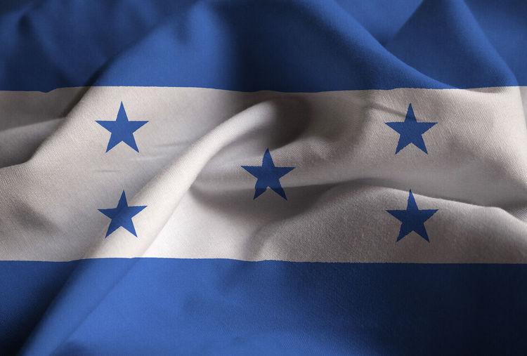 Full frame shot of flags against blue background