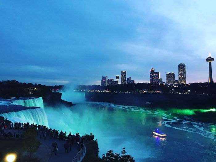 Niagara falls illuminated against sky