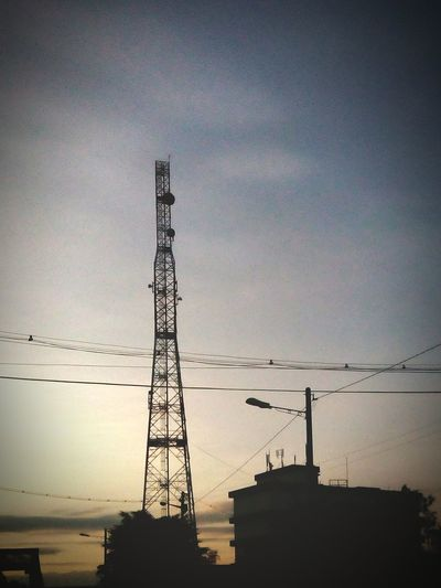 Tower of communication switching center in the middle of Pekan Tanjung Malim. Communication Tower Sunset Silhouettes Sunset Phoneography Tanjung Malim Traveling Discover Your City My City Enjoying The Sun Malaysia