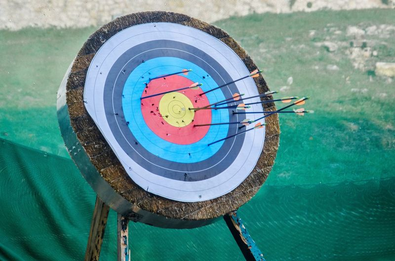 Arrows On Sports Target Against Net