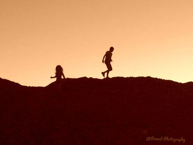 Children playing Dusk Silhouette Light And Shadow