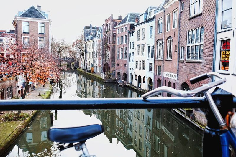 Architecture Building Exterior City Built Structure City Life Autumn Outdoors Day Tree No People Water Amsterdam Canal Bridge Canal Amsterdamcity Netherlands Sky Amsterdam Europe Eurotrip Holanda Bicycle Transportation