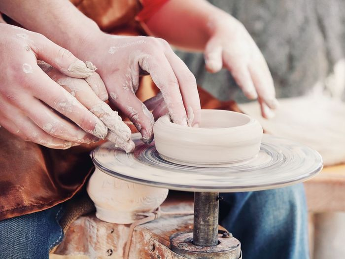 Cropped Hands Making Clay Product At Pottery