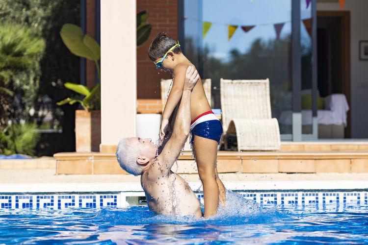 Full length of woman enjoying in swimming pool
