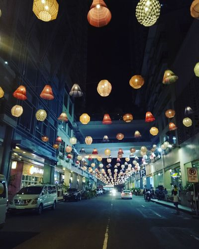 Sunshine and city lights will guide you home City Illuminated Crowd Hanging Celebration Nightlife Lighting Equipment Car Multi Colored Architecture Chandelier Lantern Chinese Lantern Paper Lantern Hanging Light Light Fixture Light Lit Festival Ceiling