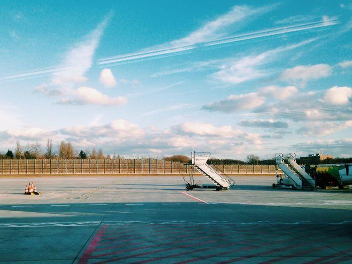 Passenger boarding bridges on airport runway