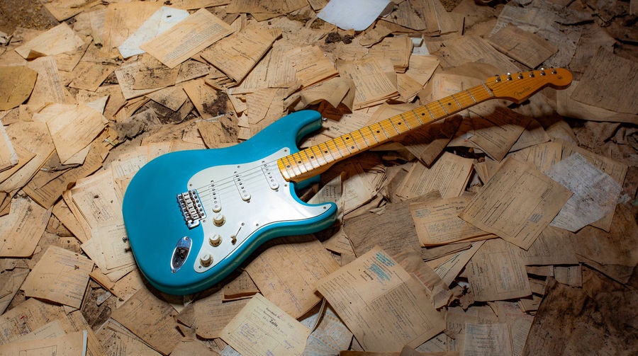 String Instrument Musical Instrument Guitar Music Musical Equipment Wood - Material Indoors  High Angle View No People Electric Guitar Broken Arts Culture And Entertainment Man Made Object Man Made Still Life Damaged Flooring Day Creativity Blue Fender Fender Stratocaster Gitarre EyeEmNewHere