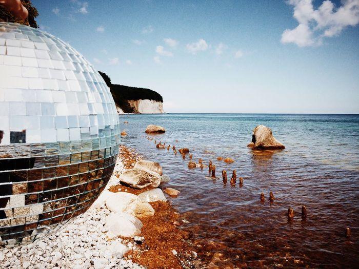 Dome at beach against sky