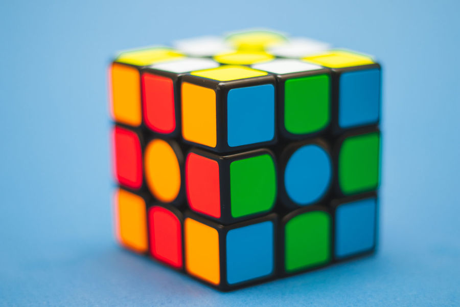 3x3 Math Rubik's Cube Smart Square Arts Culture And Entertainment Blue Blue Background Blur Close-up Colored Background Contrast Cube Shape depth of field Geometric Shape Intelligence Leisure Games Multi Colored Prime Lens Rubik's Cube Shallow Shape Studio Shot Toy Toy Block
