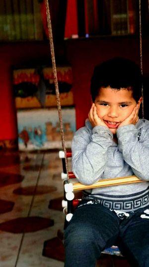 O Balançado Profundity Child Portrait Childhood Sitting Looking At Camera Boys Full Length Happiness First Eyeem Photo
