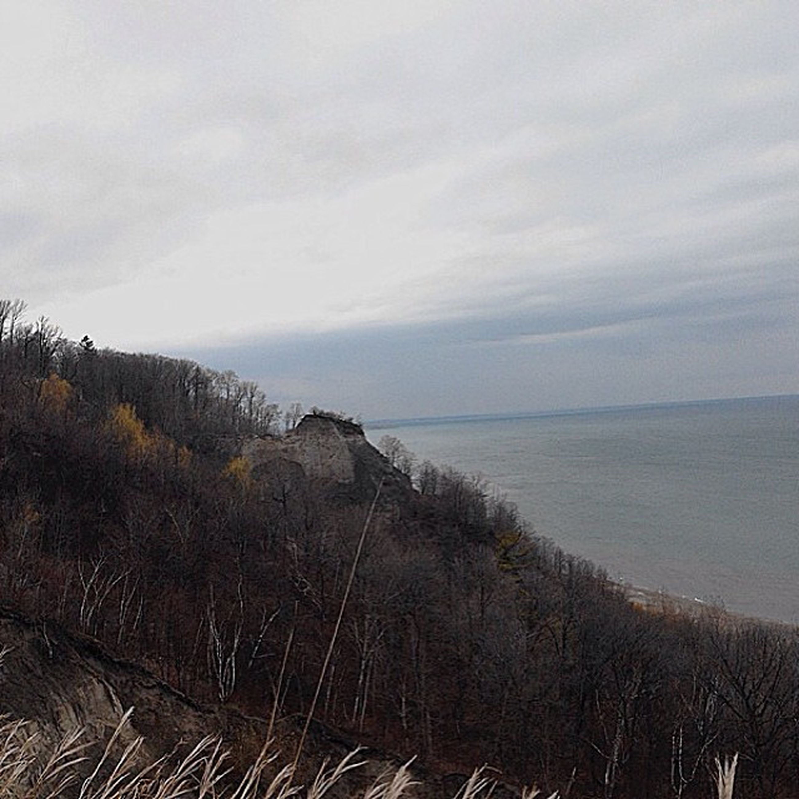 sea, water, tranquil scene, horizon over water, tranquility, scenics, sky, beach, beauty in nature, nature, shore, coastline, sand, idyllic, cloud - sky, remote, non-urban scene, day, high angle view, calm