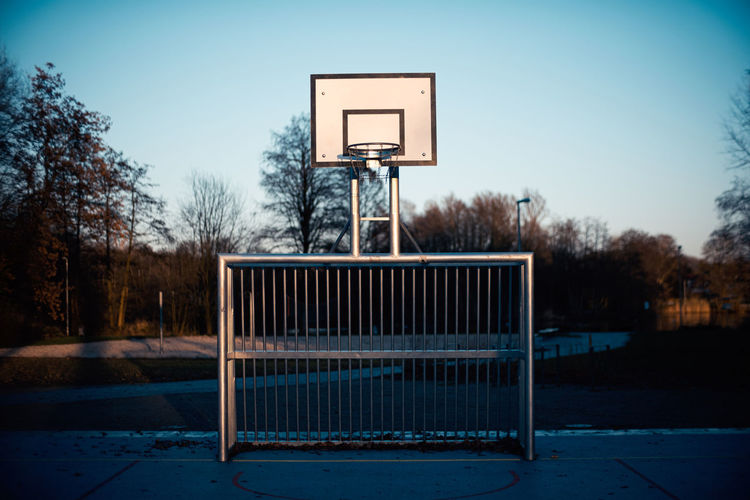 View of basketball hoop and soccer goal against sky