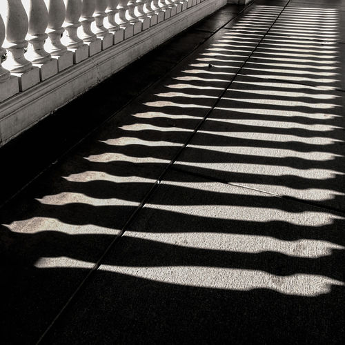 Absence Architecture Backgrounds Built Structure Day Direction Flooring Focus On Shadow Footpath High Angle View In A Row Light And Shadow No People Pattern Railing Repetition Shadow Striped Sunlight The Way Forward