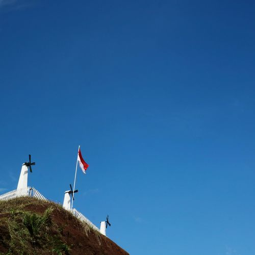 Indonesian Flag EyeEmNewHere A New Perspective On Life INDONESIA Indonesian Flag Minimalism Blue Bukit Windmill Politics And Government Patriotism Government Statue Architecture Building Exterior National Icon National Flag Symbolism Independence