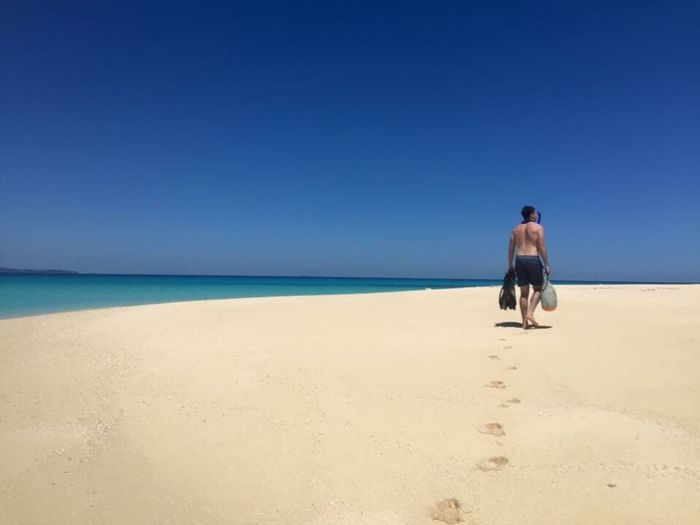 Lost In The Landscape Beach Sea Rear View Sand Full Length Dog Pets Togetherness Walking Sky Blue Clear Sky Sunny Horizon Over Water Mature Adult Secluded Beach Azure Nature Vacations Tranquility Island Snorkeling Footprints Alone