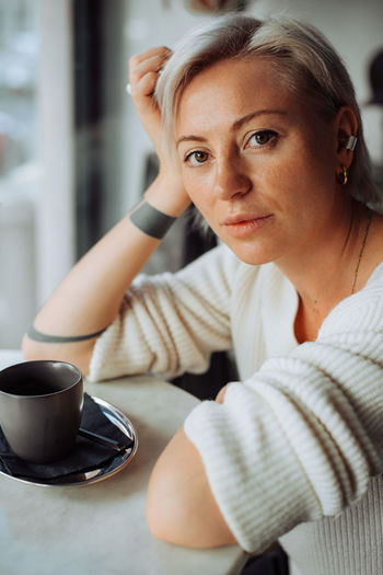 Portrait of woman with coffee cup