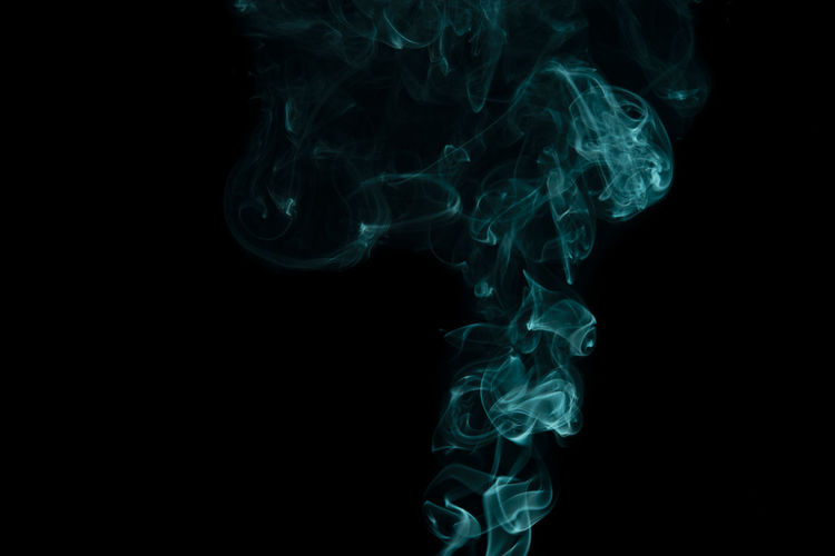 Abstract Black Background Changing Form Close-up Copy Space Cut Out Design Flowing Incense Indoors  Motion Moving Up Nature No People Pattern Pollution Smoke - Physical Structure Smoking Issues Studio Shot Swirl Underwater Water