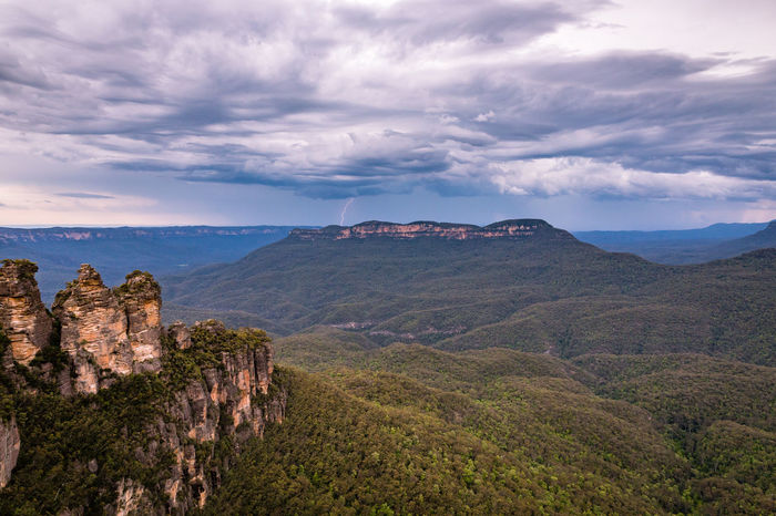 Angry Sky over the Blue Mountains. Beauty In Nature Cliff Cloud Cloud - Sky Cloudy Day Geology Landscape Lightning Lightning Bolt Mountain Mountain Range Nature Non-urban Scene Outdoors Physical Geography Remote Rock Rock - Object Rock Formation Rocky Scenics Sky The Great Outdoors - 2016 EyeEm Awards Travel Destinations