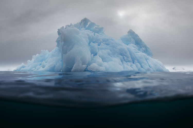 Iceberg In Sea Against Sky