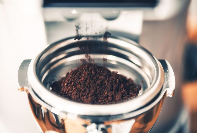 Filing Portafilter with Fresh Coffee. Coffee Grinder Closeup. Coffee Bowl Brown Close-up Coffee Coffee - Drink Container Focus On Foreground Food Food And Drink Freshness Gringer Ground Coffee High Angle View Indoors  Jar Metal No People Portafilter Preparation  Selective Focus Spice Still Life