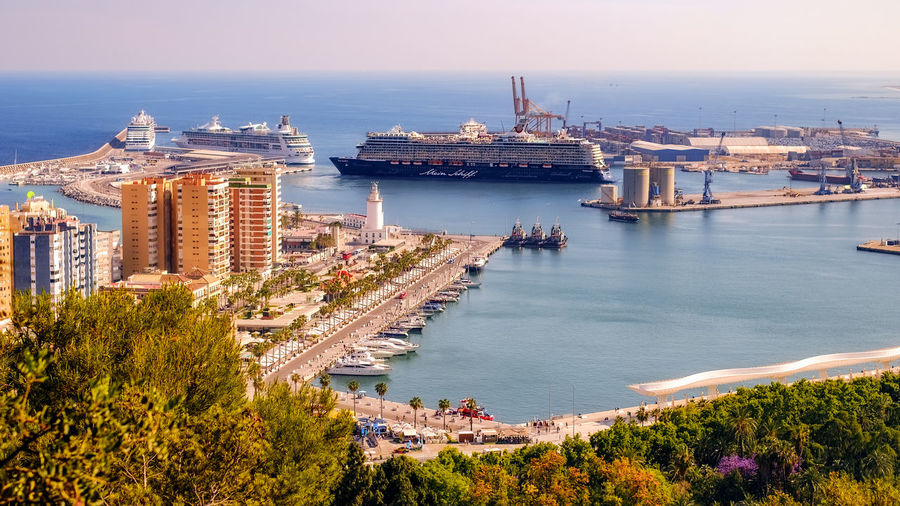 Malaga, Spain - May 18, 2018. Cruise ship Mein Schiff 5 passes the cruises Seven Seas Explorer and Rhapsody Of The Seas as it leaves the port of Malaga, Spain 2018 Cruise Ship Harbor Luxury Cruise Ships Malaga May Mein Schiff 5 Rhapsody Of The Seas SPAIN Seven Seas Explorer Architecture Building Building Exterior Built Structure City Cityscape Cruise Ship Day High Angle View Leaves Luxury Cruise Mode Of Transportation Nature Nautical Vessel Navigation No People Outdoors Roberto Sorin Sea Ship Sky Tourism Tourist Destination Transportation Travel Travel Destinations Water The Great Outdoors - 2018 EyeEm Awards