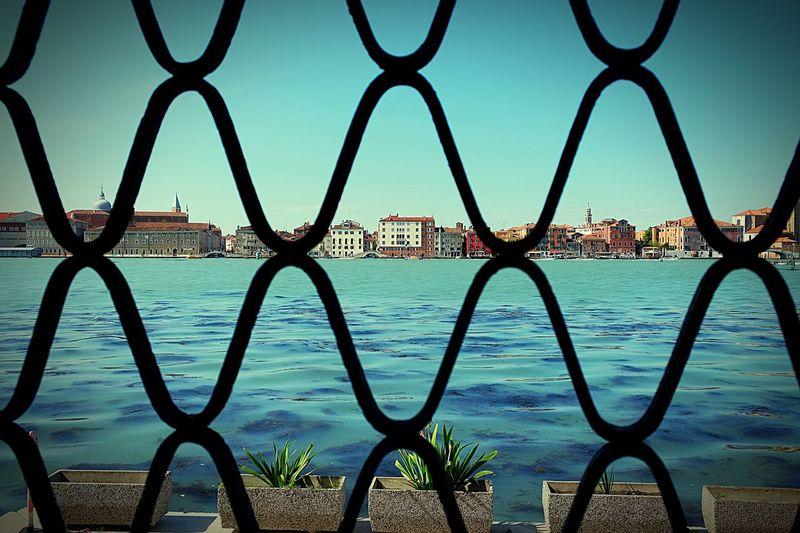 View of city seen through bridge