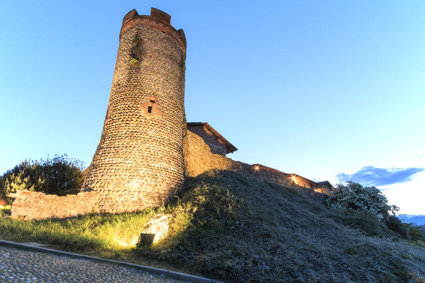 Candelo, Biella - May 4, 2016: Panoramic view of the Medieval village of Ricetto di Candelo in Piedmont, used as a refuge in times of attack during the Middle Age. Ancient Architecture Biella Blue Built Structure Candelo Candelo In Fiore Castle Clear Sky Day Famous Place History Italy Low Angle View Medieval Village Monument No People Outdoors Ricetto Di Candelo  Sky Sunlight The Past Tourism Travel Destinations Tree