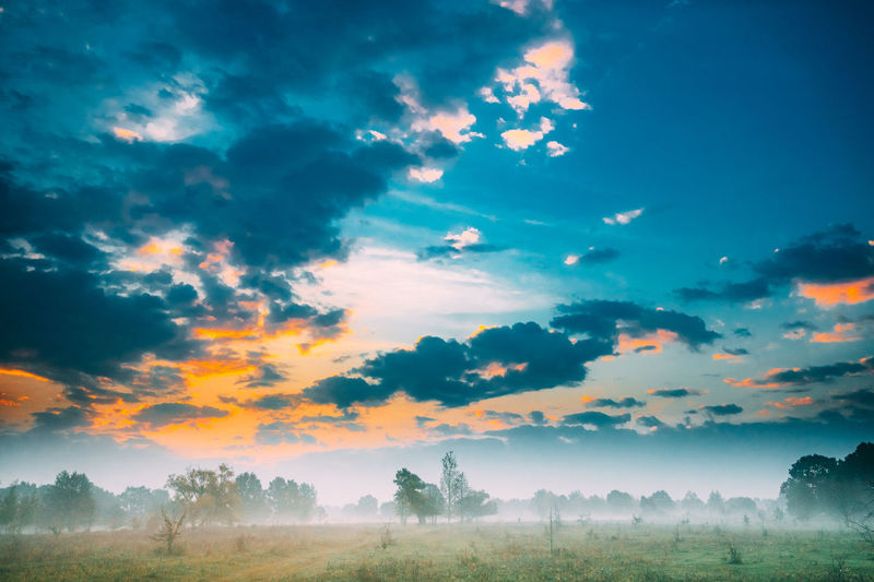 Misty Landscape. Scenic View. Morning Sunrise Sky Over Misty Meadow. Autumn Nature Of Belarus Or European Part Of Russia. Scenic View. Sky Clouds Fog Sunset Sunrise Landscape Blue Orange Durk Hazy  Nature Night Misty Foggy Meadow Belarus