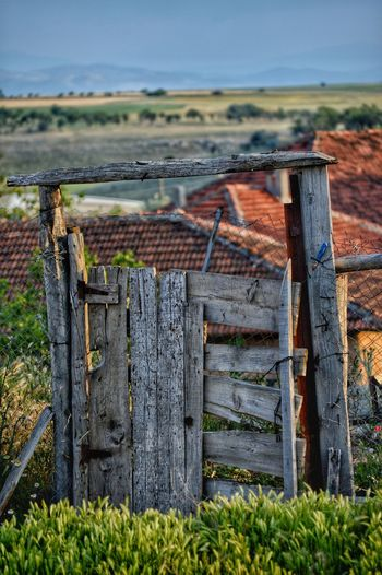 Wooden Fence Wood - Material No People Nature Day Boundary Barrier Fence Outdoors Field Landscape Rural Scene