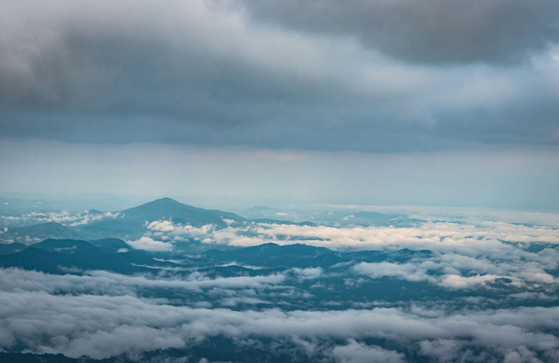 Aerial view of cloudscape over mountains