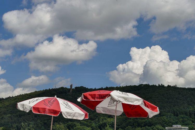 Marburg An Der Lahn Sommergefühle Wolkenhimmel Wärme Beauty In Nature Cloud - Sky Day Field Grass Hitze Landscape Nature No People Outdoors Red Shelter Sky Sonnenschirme