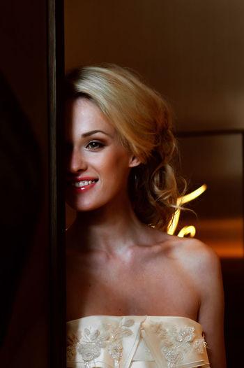 Beautiful woman in dress standing by door