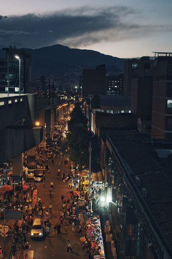 Medellin at night 2 Swinginginaplumtree Medellin Colombia Medellín Streetphotography Blue Sky Background Architecture Built Structure City Building Exterior Illuminated Car Transportation City Life High Angle View Land Vehicle Large Group Of People Sky Cityscape Outdoors Night Road People