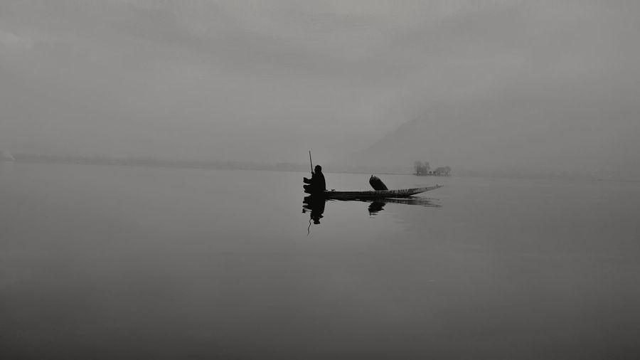 An awful calm kept my heart afloat... . Behind the lens:>@iehsanulhaq Indiapictures Bnw_collection Getty Images Getting Creative EyeEm Best Shots Ir_photographers_club Monochrome Bnw_captures Magnumphotos Weeklyfeature Bnwsouls Kashmir Lenspersia Instagram Hikaricreative Suretialem Nature Gondola - Traditional Boat Rowing Water Nautical Vessel Oar Silhouette Floating On Water Reflection Lake Fog Gondolier Sport Rowing Paddleboarding Rowboat Boathouse Fisherman