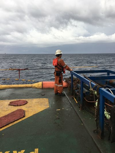 Side view of worker standing at offshore platform